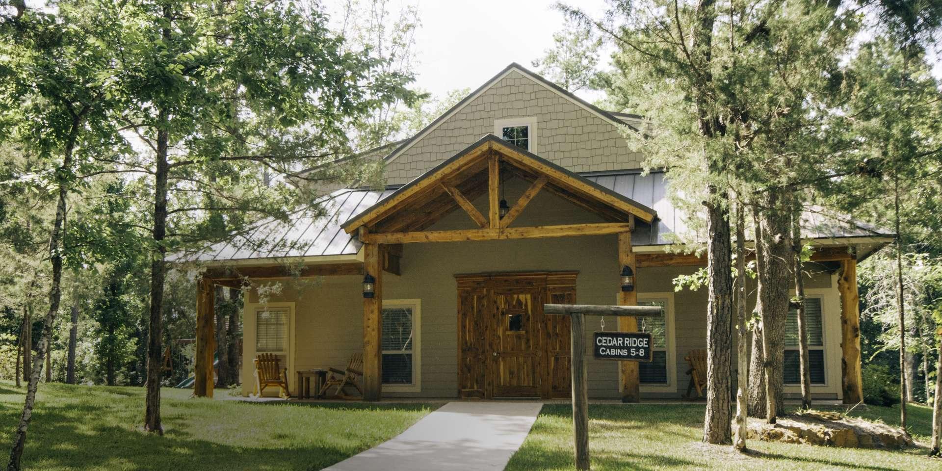 Woods_familycamp-cabinoutside-wide